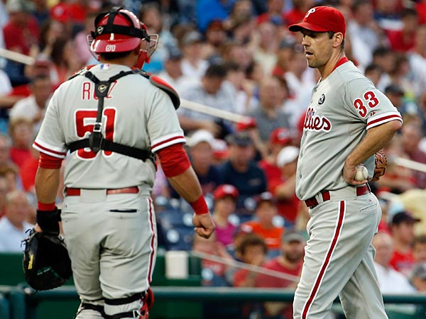 Carlos Ruiz (51) walks to talk with starting pitcher Cliff Lee (33), after Lee stepped off the mound during the third inning of a baseball game at Nationals Park Thursday, July 31, 2014, in Washington. The Phillies announced that Lee had a recurrence of the left flexor pronator strain that sidelined him in May. (Alex Brandon/AP)