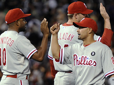Ben Francisco, left, congratulates Shane Victorino after the Phillies´ 4-3 win over the Colorado Rockies. (AP Photo/Chris Schneider)