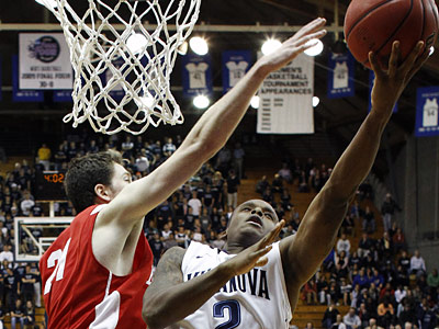 Boston University forward Jake O´Brien defends against Villanova guard Maalik Wayns during a 2010 game. (AP File Photo)