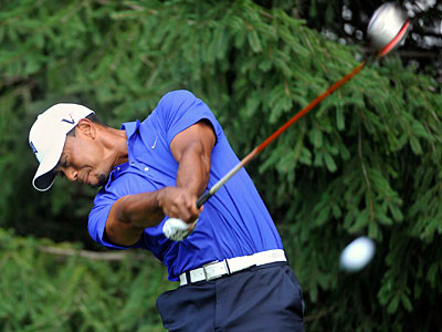 Tiger Woods hits his tee shot on the second hole during a practice round at the Bridgestone Invitational. (AP Photo/Phil Long)