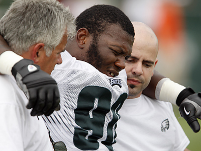Antonio Dixon was carted off the field yesterday at training camp with a concussion. (David Maialetti / Staff Photographer)