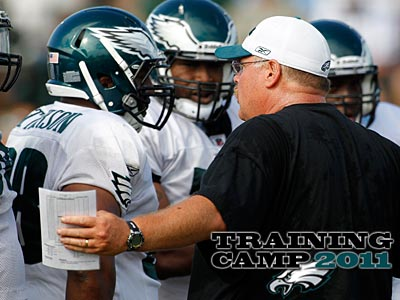 Andy Reid addresses Mike Patterson before he collapsed during practice. (Alex Brandon/AP)