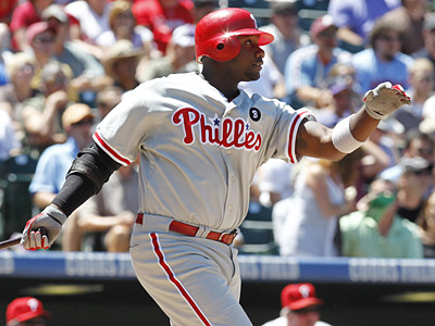 Ryan Howard hits a two-run double in the second inning against the Rockies on Wednesday. (Ed Andrieski/AP)