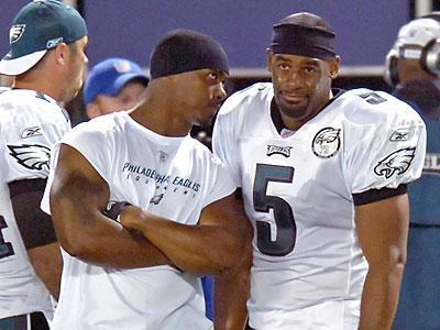 Brian Dawkins and Donovan McNabb are two Andy Reid-era players who have a shot at making the Hall of Fame. (Bill Kostroun/AP file photo)