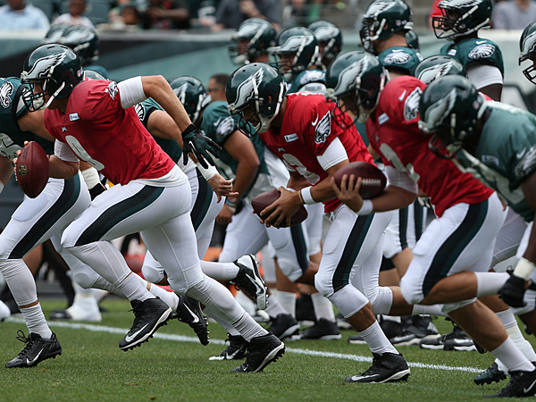 Nick Foles and the Eagles practice at Lincoln Financial Field during training camp on August 3, 2014. (David Maialetti/Staff Photographer)