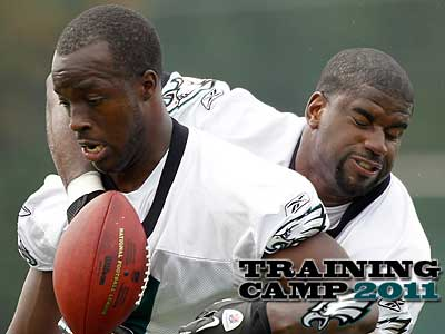 Ricky Sapp (left) and Victor Abiamiri (right) are no longer at Eagles camp in Lehigh. (Alex Brandon/AP)