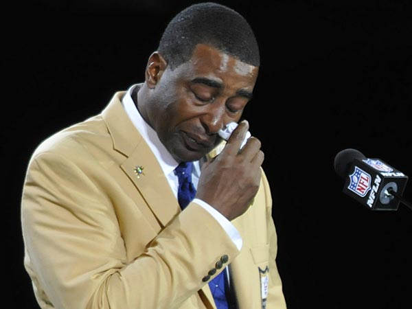 Hall of Fame inductee Cris Carter speaks during the induction ceremony at the Pro Football Hall of Fame Saturday, Aug. 3, 2013, in Canton, Ohio. (David Richard/AP)