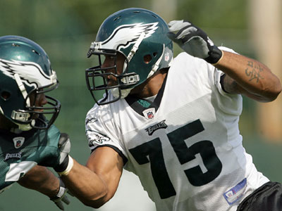 Juqua Parker (right) pushes Eugene Bright during training camp drills last Thursday. (Yong Kim / Staff Photographer)