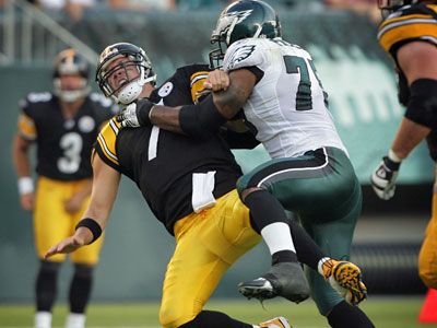 Steelers quarterback Ben Roethlisberger is smashed by the Eagles Juqua Parker, forcing an incompletion during a game last September. Parker was arrested overnight for possessing a small amount of marijuana. (Jerry Lodriguss / Staff Photographer)