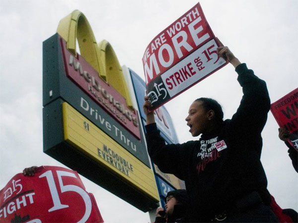 Fast-food worker Michelle Osborn, 23, of Flint, Mich. shouts out chants as she and a few dozen others strike outside of a McDonald´s restaurant on Wednesday, July 31, 2013 in Flint. A few thousand fast-food workers in seven cities took to the streets demanding better pay, the right to unionize and a more than doubling of the federal minimum hourly wage from $7.25 to $15. (AP Photo/The Flint Journal, Jake May/File)