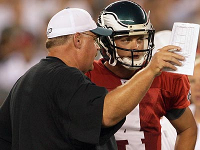 Coach Andy Reid and quarterback Kevin Kolb meet on the sideline during Flight Night. (Yong Kim / Staff Photographer)