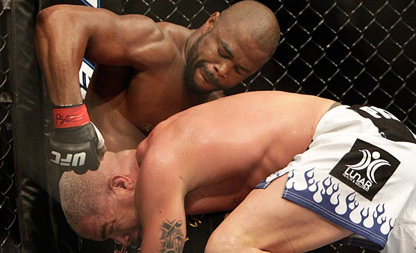 Rashad Evans (top) defeated Tito Ortiz in the second round of the UFC 133 main event on Saturday at the Wells Fargo Center. (David Maialetti/Staff Photographer)