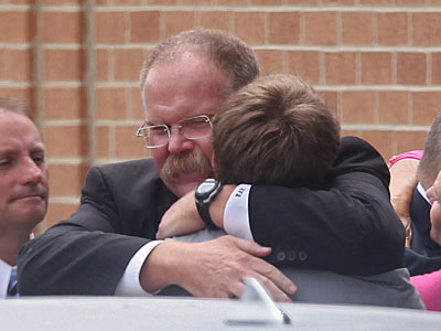 Eagles head coach Andy Reid hugs his son Britt following the memorial service for his son Garrett. (Michael Bryant/Staff Photographer)