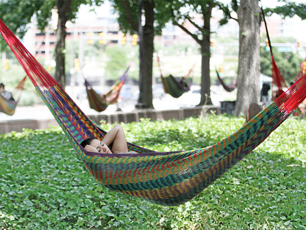 Ashley Gonzalez, 19, takes a snooze in one of the 50 hammocks hanging in the newly opened Spruce Street Harbor Park Monday, June 30, 2014. The pop-up park is along the Marina at Penn´s Landing, near the Christopher Columbus monument.