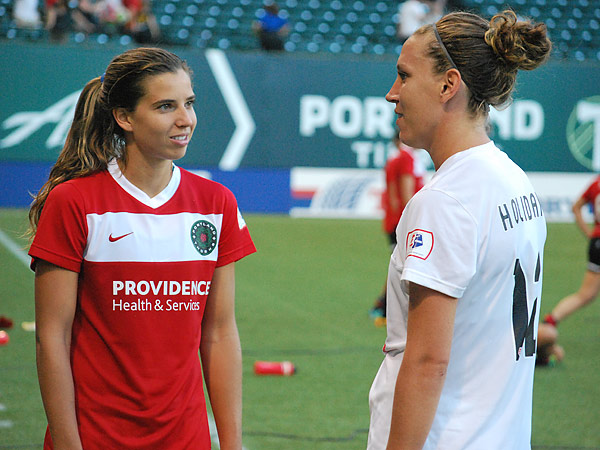 Lauren Holiday (right) chats with fellow U.S. national team star Tobin Heath after Sunday´s Portland Thorns-FC Kansas City game at JELD-WEN Field. (Jonathan Tannenwald/Philly.com)