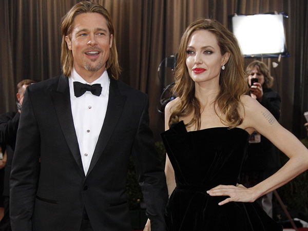 FILE - This Feb. 26, 2012 file photo shows actress Angelina Jolie, right, and actor Brad Pitt at the 84th Academy Awards in Hollywood. The couple has produced a rose that Wine Spectator has named as one of the top 100 wines in the world.  (AP Photo/Amy Sancetta, File)