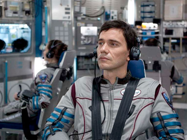 Christian Camargo and Karolina Wydra are two of six astronauts fighting for their lives on a flight to Europa, a moon of Jupiter.
