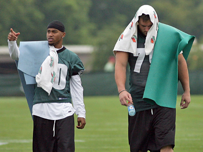 DeSean Jackson (left) and Todd Herremans walk off the field after completing a rehab workout at training camp today.  (Yong Kim / Staff Photographer)