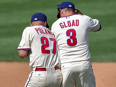 Placido Polanco and Ross Gload celebrate the Phillies´ victory yesterday over the Mets. (David M Warren / Staff Photographer)