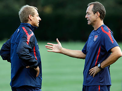 Thomas Dooley (right) chats with U.S. national team coach Jurgen Klinsmann at Tuesday´s practice. (Alex Brandon/AP)