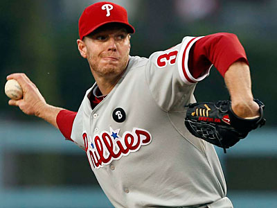 Roy Halladay gets the start tonight against the Brewers. (Alex Gallardo/AP)