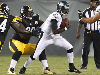 Michael Vick gets sacked by the Steelers´ Steve McLendon in the first half on Thursday. (Ron Cortes/Staff Photographer)