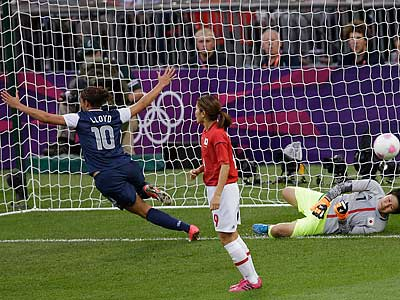 Carli Lloyd celebrates after scoring one of her two goals in the gold-medal game. (Andrew Mendichini/AP)