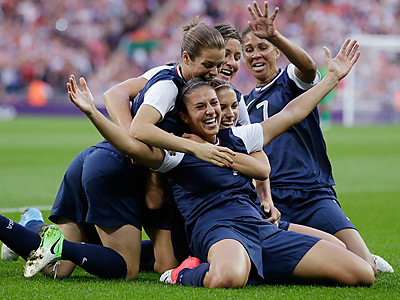 Carli Lloyd, center, celebrates her first-half goal with her teammates. (AP Photo/Ben Curtis)