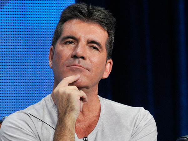 "Simon Cowell, a judge on the FOX series ""The X Factor,"" considers a reporter´s question during a panel discussion on the show at the FOX 2013 Summer TCA press tour at the Beverly Hilton Hotel on Thursday, Aug. 1, 2013, in Beverly Hills, Calif. (Photo by Chris Pizzello/Invision/AP)"
