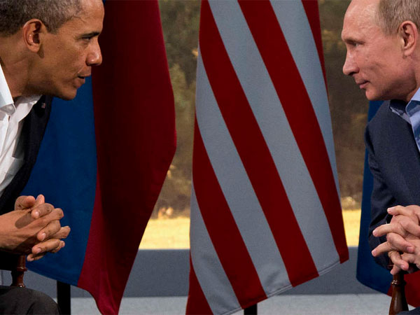 President Obama meeting with Russian President Vladimir V. Putin in Northern Ireland in June. U.S. lawmakers and human-rights groups praised Obama´s canceling talks. (AP File Photo)