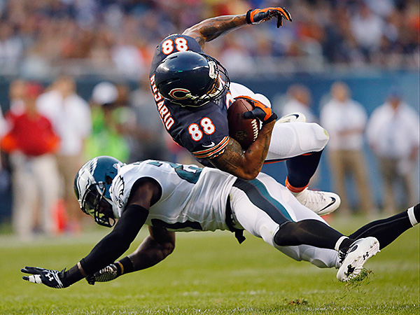 Chicago Bears tight end Dante Rosario (88) collides with Philadelphia<br />Eagles safety Malcolm Jenkins (27). (AP Photo/Charles Rex Arbogast)