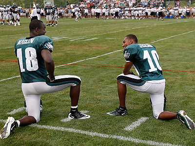 Jeremy Maclin, left, and DeSean Jackson talk today during the morning practice. (David Maialetti / Staff Photographer)
