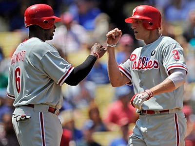 Ryan Howard and Hunter Pence both hit home runs against the Dodgers on Wednesday. (Mark J. Terrill/AP)