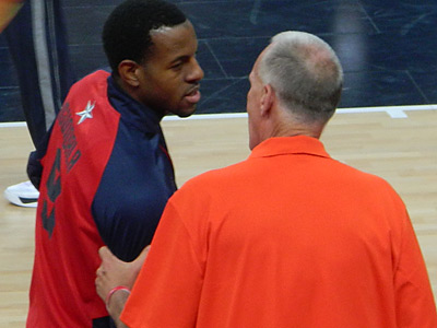 Sixers coach Doug Collins talks to his former player Andre Iguodala before the U.S. plays Argentina. (Photo by Phil Sheridan)