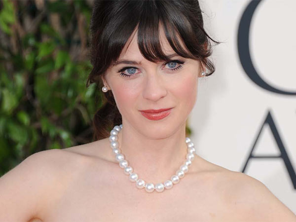 Zooey Deschanel arrives at the 70th Annual Golden Globe Awards at the Beverly Hilton Hotel on Sunday Jan. 13, 2013, in Beverly Hills, Calif. (Photo by Jordan Strauss/Invision/AP)