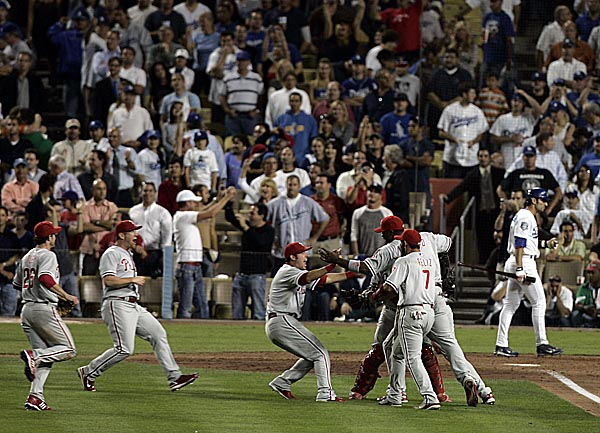 The Philadelphia Phillies celebrate as they advance to the World Series after beating the Dodgers in game five of the NLCS at Dodger Stadium October 15, 2008. ( Michael Perez / Staff Photographer )