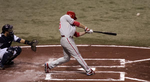 Chase Utley strokes a 2-run homer in the first inning of World Series Game One at Tropicana Field October 22, 2008. ( Michael Perez / Staff Photographer )