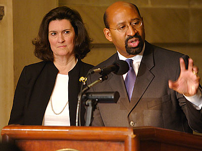 City Managing Director Camille Barnett (left) in a file photo with Mayor Michael Nutter. Barnett will announce her resignation today, say sources. (John Costello/Staff Photographer)