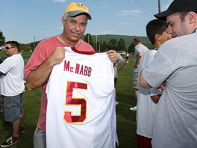 Jim Devlin shows his new Redskins McNabb jersey that he was asked to remove this morning at training camp. (Steven M. Falk/Staff Photographer)