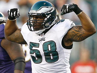 Eagles defensive end Trent Cole celebrates a stop against the Ravens on Thursday night. (Yong Kim/Staff Photographer)