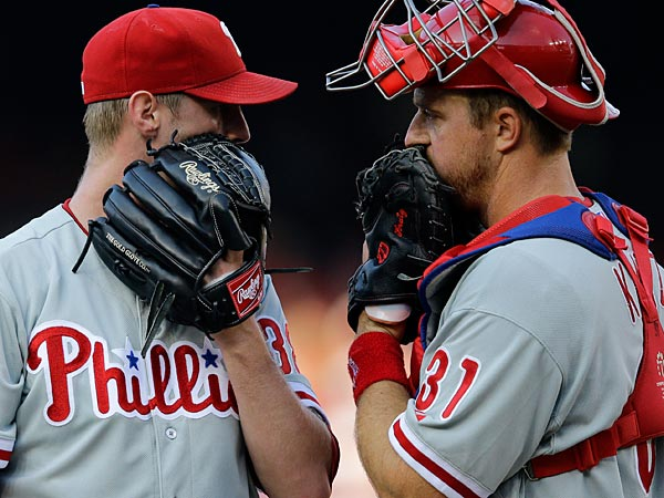 Philadelphia Phillies starting pitcher Kyle Kendrick, left, and catcher Erik Kratz (31) talk on the mound during the fourth inning. (AP Photo/Alex Brandon)