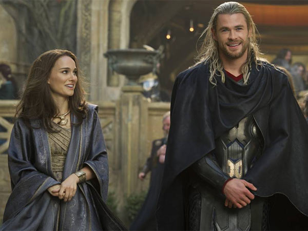 """FILE - This publicity photo released by Walt Disney Studios and Marvel shows Natalie Portman, left, as Jane Foster and Chris Hemsworth as Thor, in Marvel´s """"Thor: The Dark World."""" Disney is previewing several of the studio´s upcoming live-action films for fans at the D23 Expo, Aug. 9-11, 2013, a three-day Disney extravaganza at the Anaheim Convention Center. """"Thor: The Dark World,"""" """"Captain America: Winter Soldier,"""" """"Muppets Most Wanted,"""" """"Saving Mr. Banks"""" and """"Tomorrowland"""" are just some of the movies that will be teased at a Saturday morning presentation. (AP Photo/Walt Disney Studios/Copyright Marvel, Jay Maidment, File)"""
