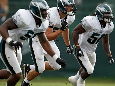 Linebackers Akeem Jordan, Stewart Bradley, and Ernie Sims practice during Eagles training camp. (David Maialetti / Staff Photographer)