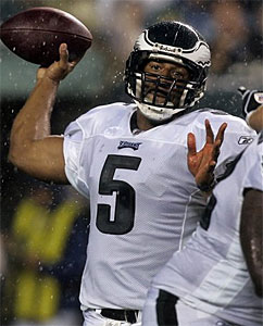 Should Donovan McNabb have come back into the game after play was delayed because of stormy weather? (Mel Evans/AP)
