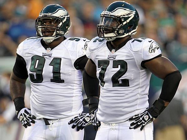 Eagles defensive lineman Fletcher Cox (left) and Cedric Thornton. (Yong Kim/Staff Photographer)