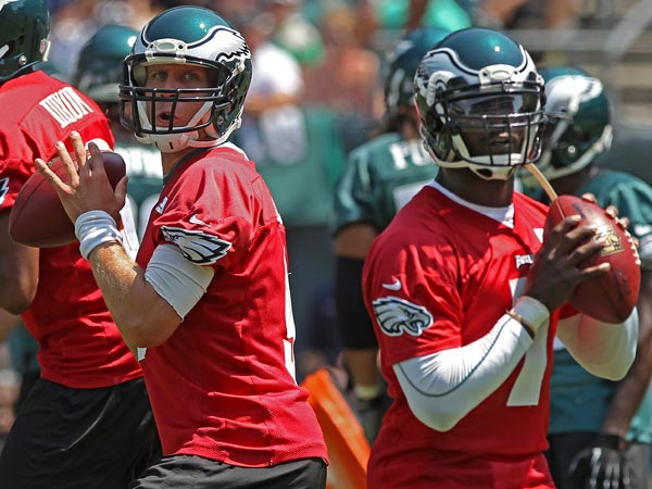 Nick Foles and Michael Vick. (Michael Bryant/Staff Photographer)