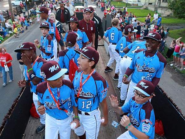 The Taney Dragons taking in a parade in Williamsport, Pa. (David Swanson/Staff Photographer)