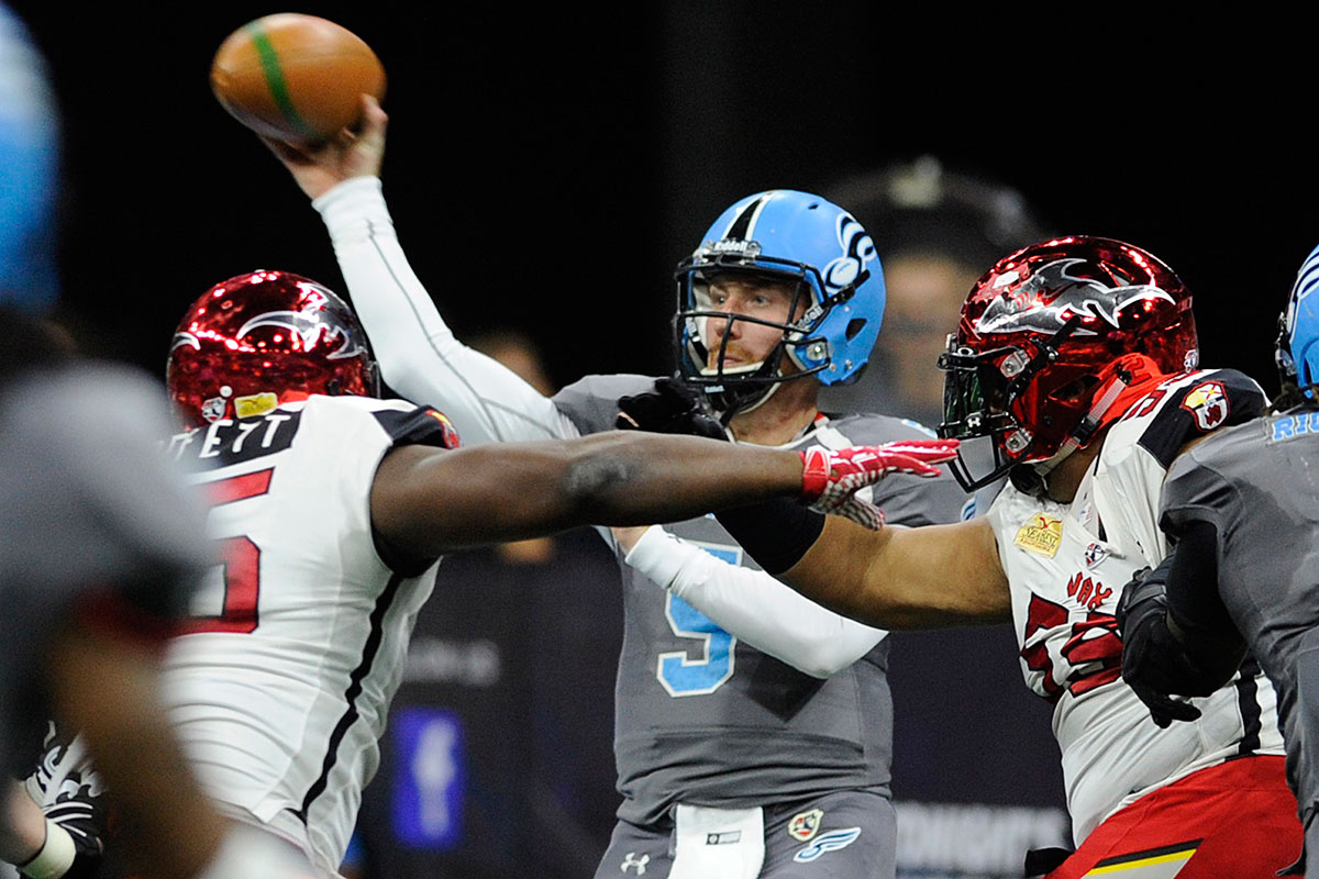 Soul quarterback Dan Radabaugh (5) throws downfield under pressure by Jacksonville defenders in the first quarter of  the 55-50 win over the Sharks in an Arena Football League conference championship game in Allentown on Sunday.<br />Radabaugh completed 26 of 38 passes for 317 yards, with six touchdowns and two interceptions.