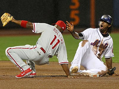 Jose Reyes reacts after being called out on the tag from Jimmy Rollins while trying to steal second in the first inning. (AP Photo/Seth Wenig)