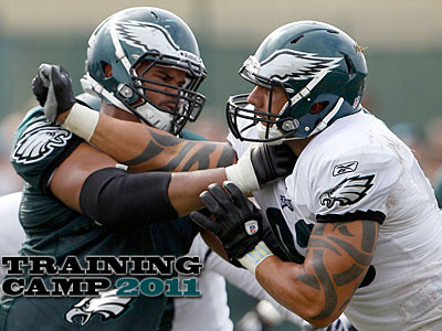 Tackle Ryan Harris, left, has sat out at Eagles camp for three days due to back spasms. (Yong Kim/Staff Photographer)